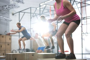 People doing box jump