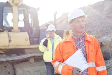Engineer holding clipboard