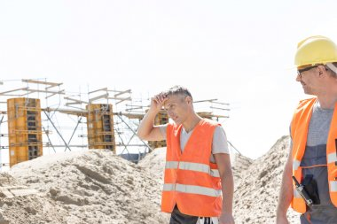 worker looking at tired colleague