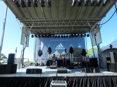 Ron Artis II & Thunderstorm performs on stage during a day conce