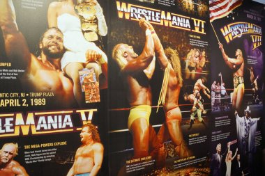 Display of Wrestlemania posters ranging from Wrestlemania 5-7