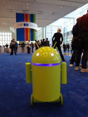Yellow-green Android robot rolls around at the Google IO Android