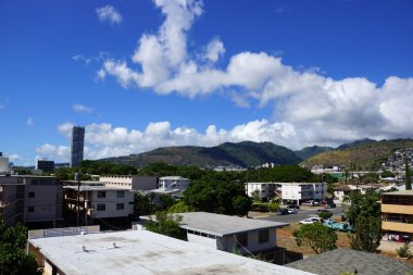Kapahulu town in Honolulu with homes, condos, and mountains of T