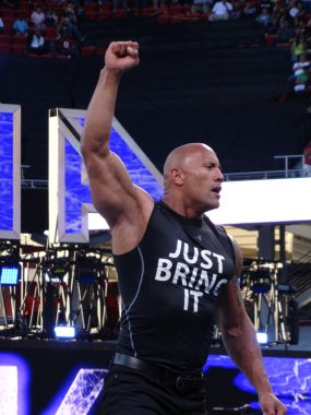 International superstar the Rock, Dwayne Johnson, holds arm in t