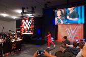 WWE Superstar Kofi Kingston walks towards ring and points