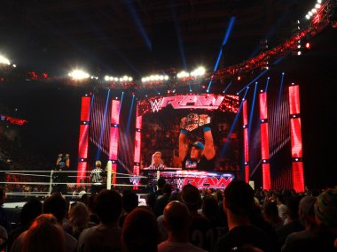 WWE Superstar John Cena holds USA Championship title in the air