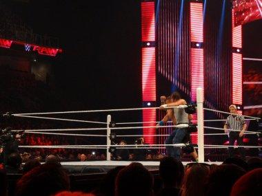 wrestler Dean Ambrose catches WWE Superstar John Cena with an el