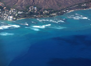 Aerial view of slopes of Diamond Head crater with road surrounde