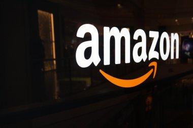 Amazon logo on black shiny wall in San Francisco mall