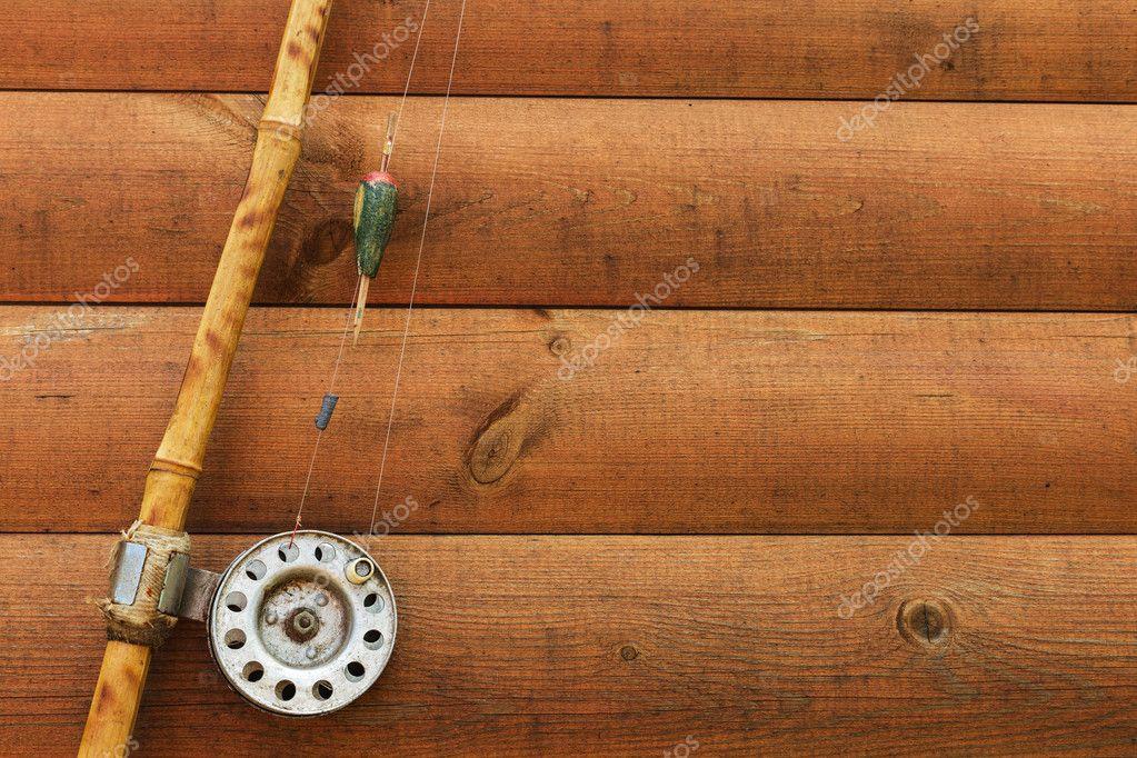 Old Fishing Rod On Wooden Background Stock Photo Koldunov 117511566