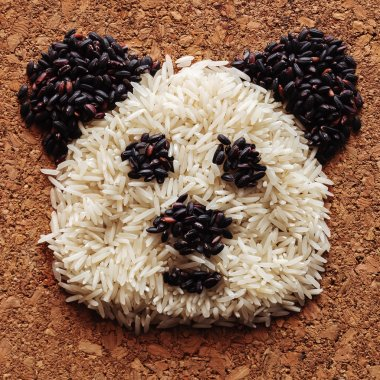 Playing with grains of rice. The head of the panda, built of cereals