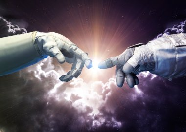 Michelangelo Gods touch. Close up of human hands touching with fingers in space. Elements of this image furnished by NASA