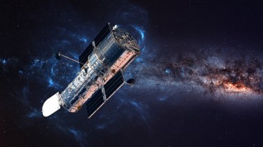 The Hubble Space Telescope in orbit above the Earth. Elements of this image furnished by NASA.