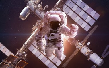 International Space Station with astronaut over the planet Earth. Elements of this image furnished by NASA