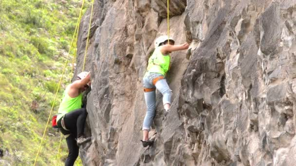 Two Rock Climbers During Competition