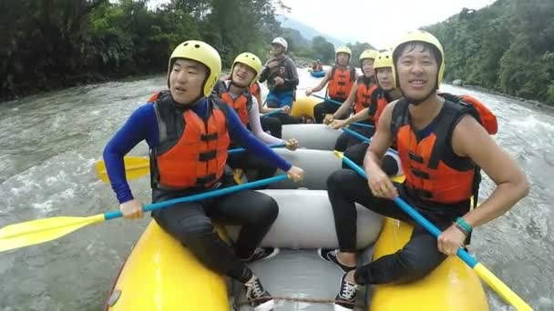 Asian Men Making Funny Faces While White Water Rafting Trip