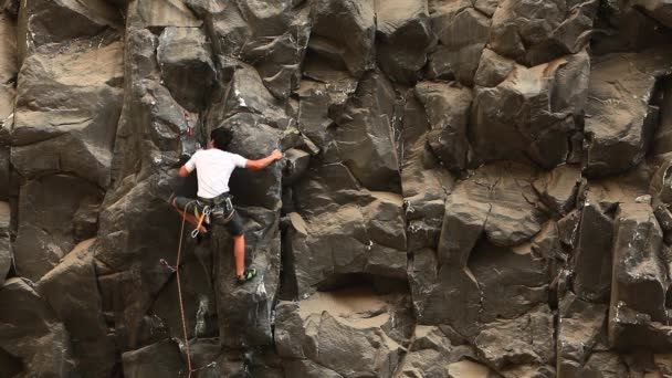 Rock Climber On Basalt Rock