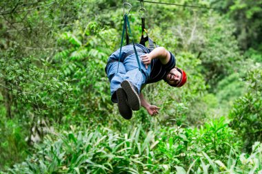 Oversized Adult Man Hanging On The Zip Line