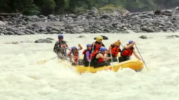 Group Of Six Young People Whitewater Rafting
