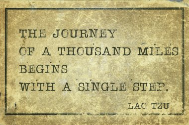 Journey of a thousand miles - ancient Chinese philosopher Lao Tzu quote printed on grunge vintage cardboar stock vector