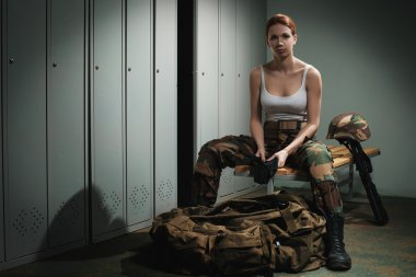 Military woman at locker room