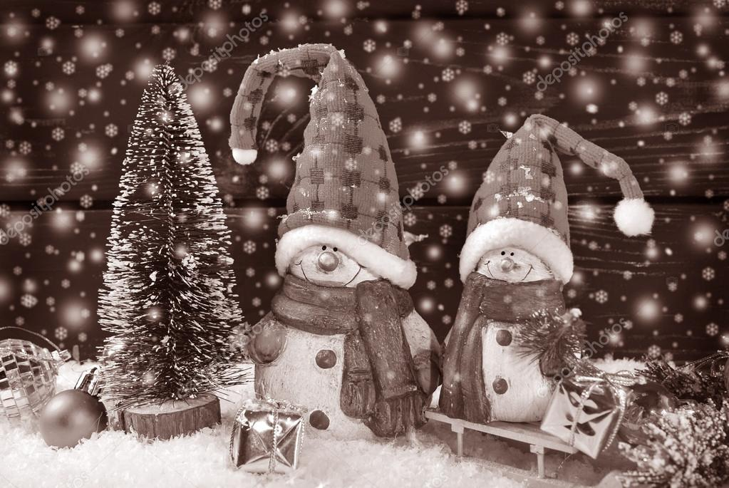 Christmas Decoration With Two Funny Santa Claus Figurines On Blue Wooden Background Vintage Style Photo By Teresaterra