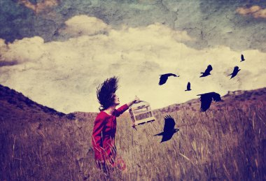 Girl in field with birds