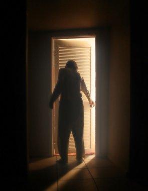 Person outside a bedroom door