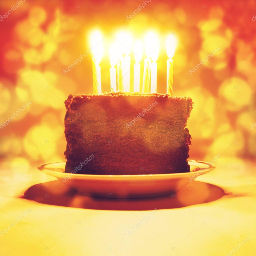 A Piece Of Birthday Cake With Candles On It Photo By