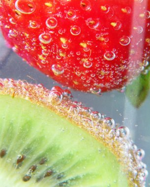 Strawberry and kiwi on drink