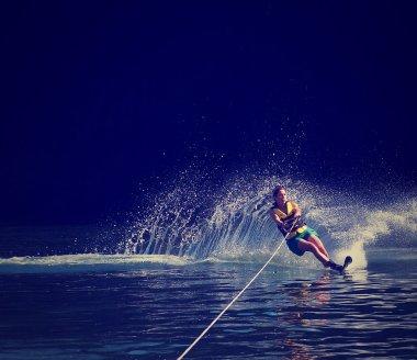 Woman water skiing on a lake
