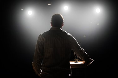 Man in front of podium and audience