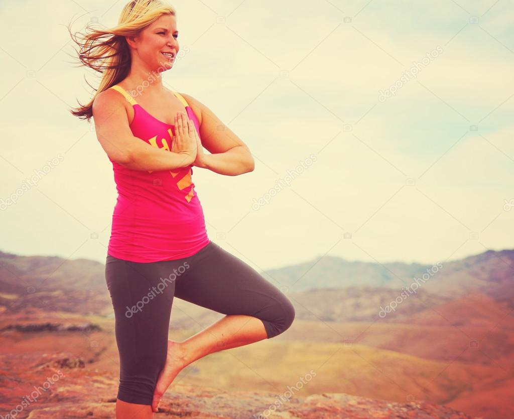 Woman meditating in yoga pose