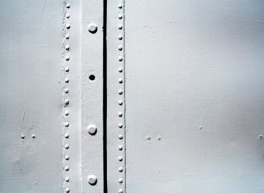 Metal surfaces with rivets
