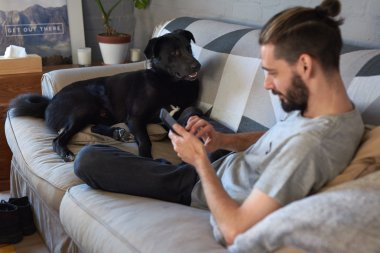Pet owner hanging out with his dog