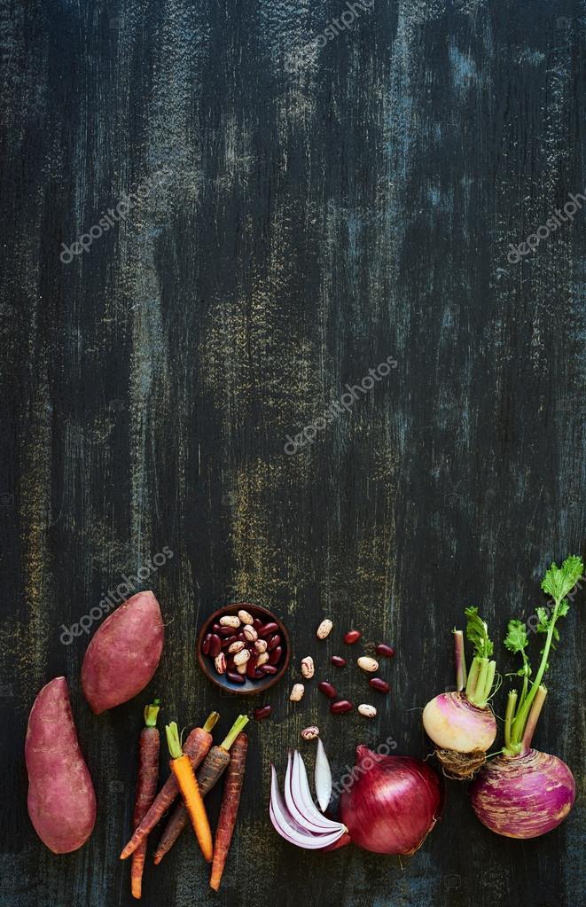 Vegetable soup ingredients on dark backgorund
