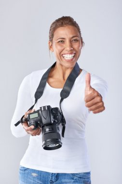 mixed race woman with dslr camera
