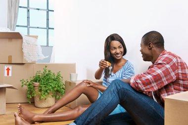 black couple celebrating their new apartment