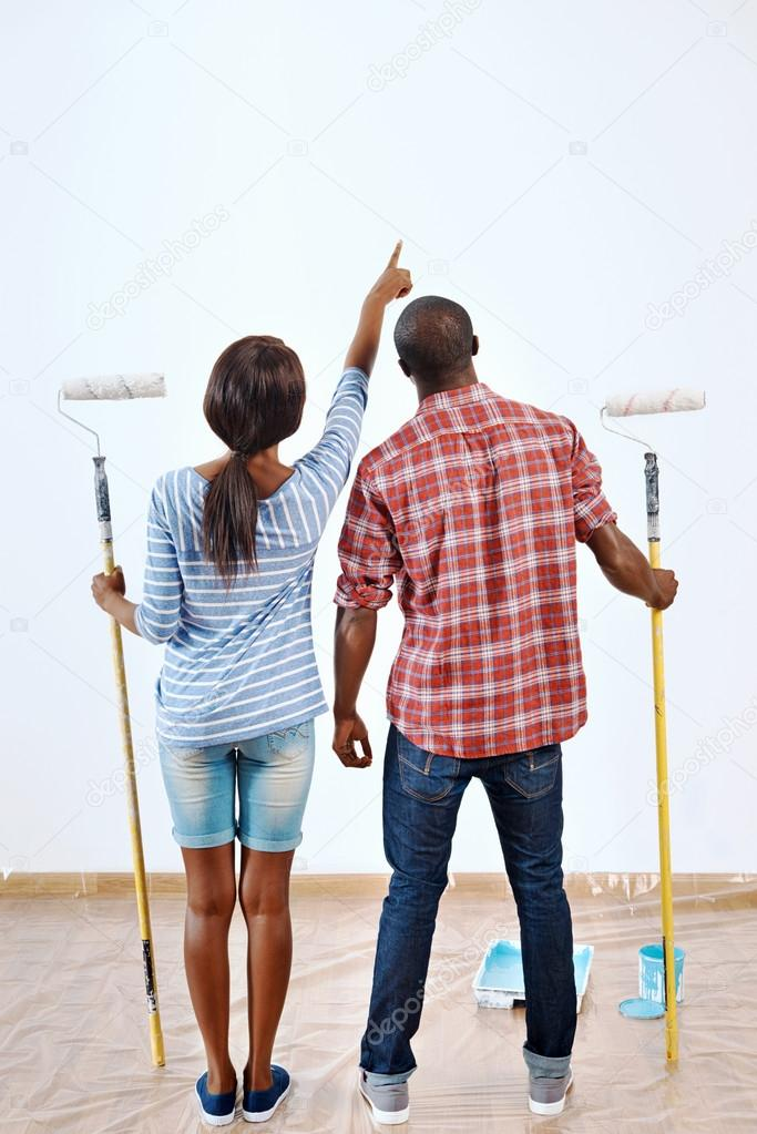 couple ready to paint new home apartment