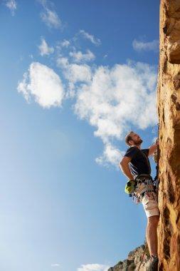 man climbing up a really steep mountain
