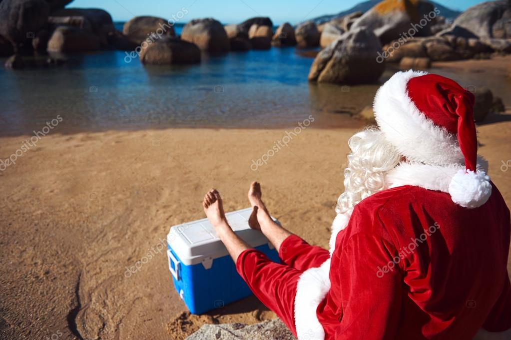 Father Christmas relaxing on the beach