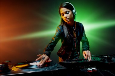 dj woman playing music on vinyl record deck