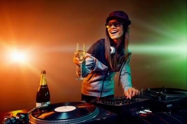 Nightclub dj at party with bubbly champagne