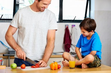 Dad and son making healthy food