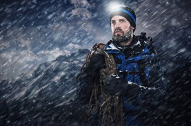 mountain man in snow blizzard