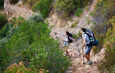 couple walking along a hiking trail