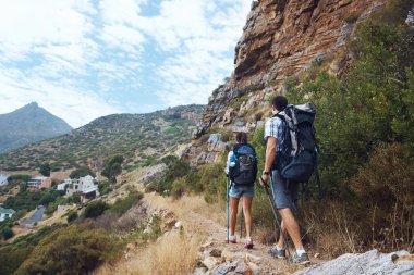 couple walking along trail