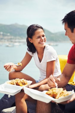 woman and partner eat fish and chips