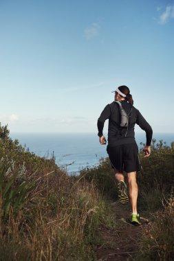 running man on mountain trail