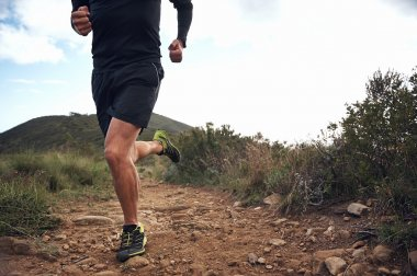 Trail running athlete exercising for fitness